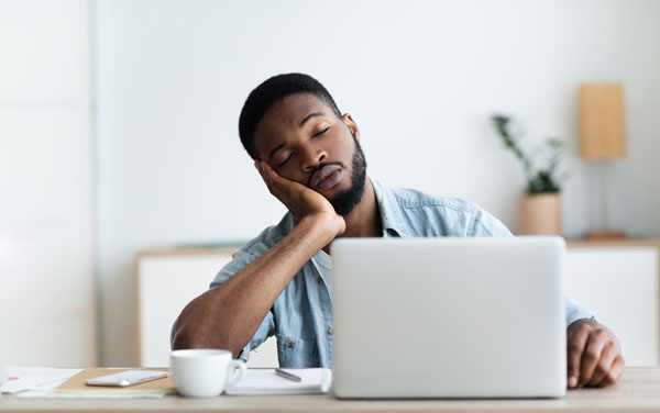Man falling asleep because your webinar is so boring